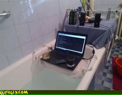 bathtub laptop what are you doing in the bathtub with your laptop