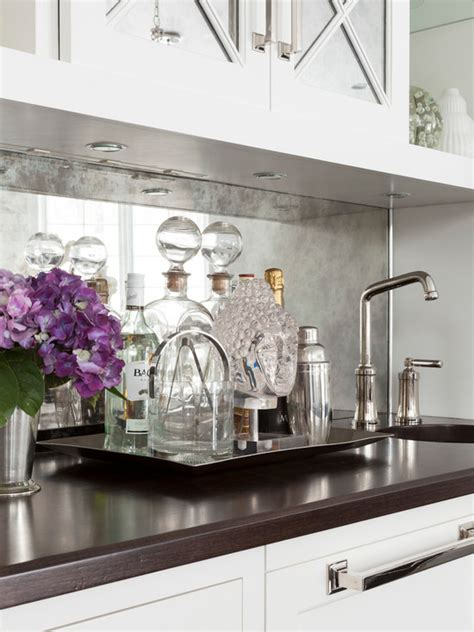 antiqued mirrored backsplash transitional kitchen susan glick interiors