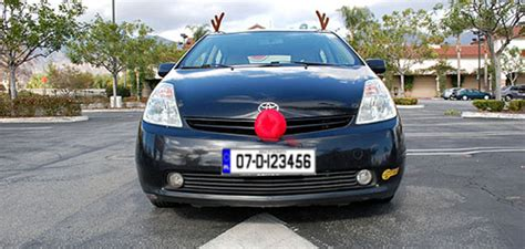 car nose with reindeer nose still on his car just taking the