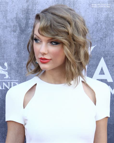 curl side bangs vertically taylor swift wearing her hair in a new short style