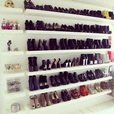 rows of shoes on ikea floating shelves organizing