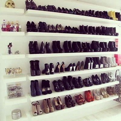 rows of shoes on ikea floating shelves organizing