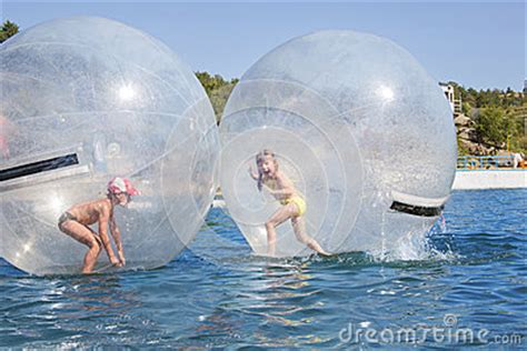 children   balloon floating  water royalty  stock photography image