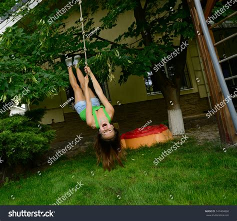 upside down swing happy excited teen girl on swing stock photo 141404860
