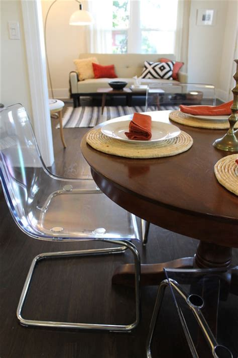 Clear Dining Room Table Modern Meets Traditional Clear Acrylic Chairs With Wooden Pedestal Table Contemporary