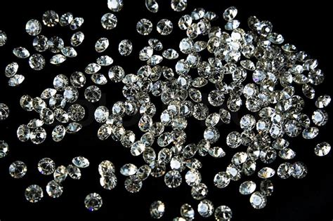 Faceted diamonds on a dark background   Stock Photo