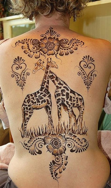 cute back tattoos giraffes with floral patterns on back