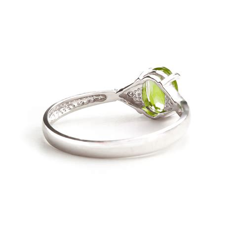 peridot and ring 0 45ct in 9ct white gold