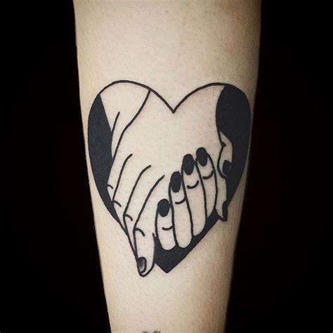 holding hands tattoo black holding inspiration
