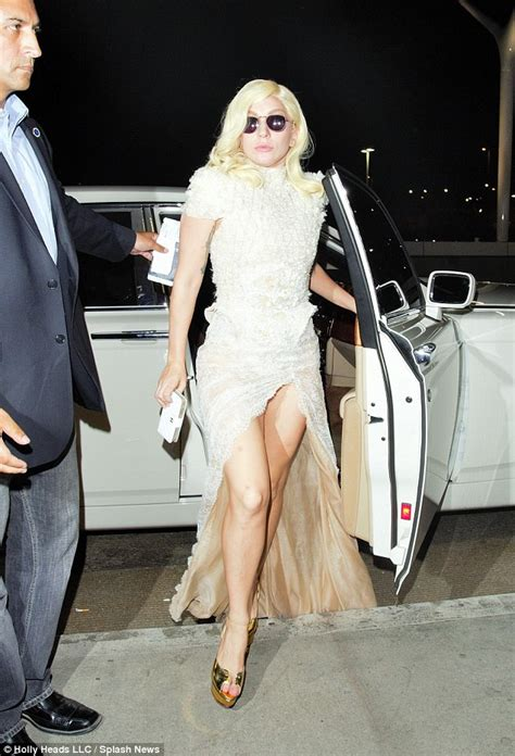 arriving in style lady gaga chose a vintage cadillac to take her to lady gaga exhibits her toned legs in wedding inspired