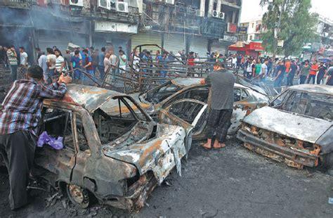 people inspect  site   suicide car bombing