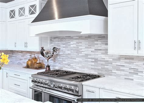 white cabinet marble countertop modern subway kitchen