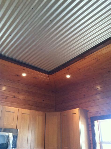 log siding in tin interesting tin ceiling framed by tounge and groove pine