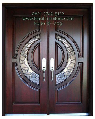 pintu utama jati pliture kupu tarung mewah klasik