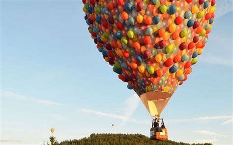 film up com the balloon house from disney s up is flying over