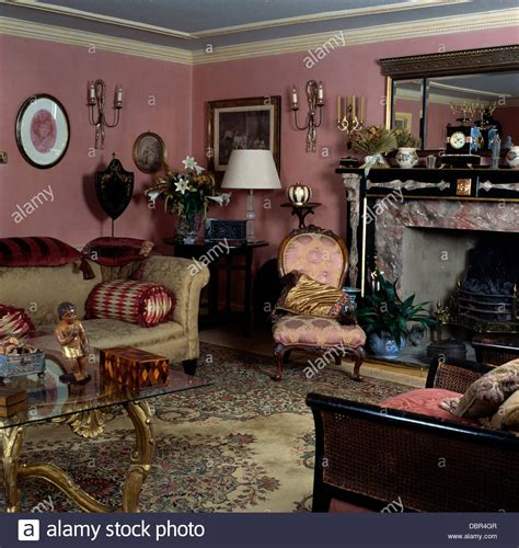 old fashioned living room damask silk victorian chair and beige sofa in dark pink