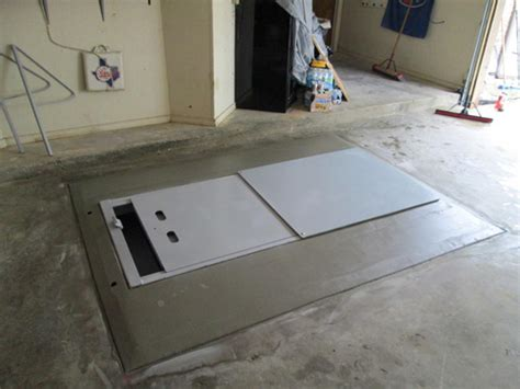 Garage Floor Shelter by Installation Of A Tornado Shelter Just In Time For A