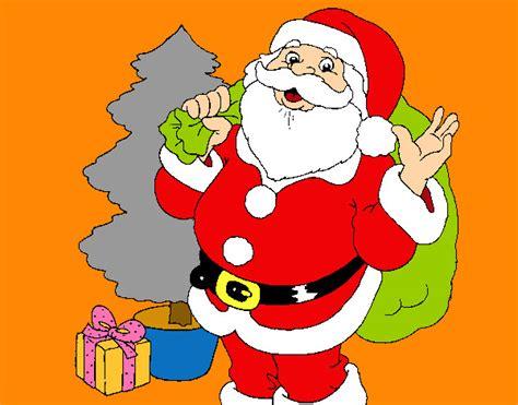 dibujo de santa claus y un rbol de navidad pintado y