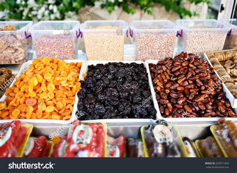 Dried Dates Shelf by Dried Fruits On Food Store Shelf On Fruit Market Apricot