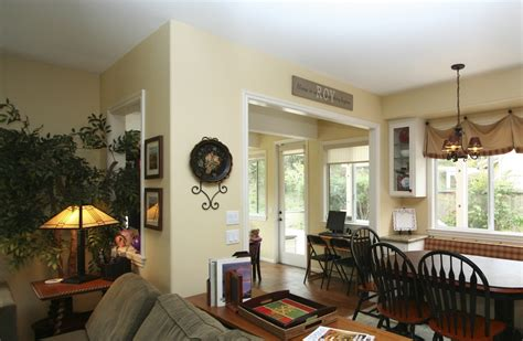 stylish transitional family room robeson design san stylish transitional dining room before and after robeson