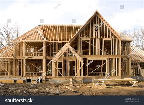 construction of a house large mcmansion type house under construction in framing