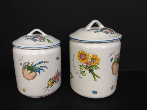 1990s two white ceramic kitchen canisters w fruit flowers