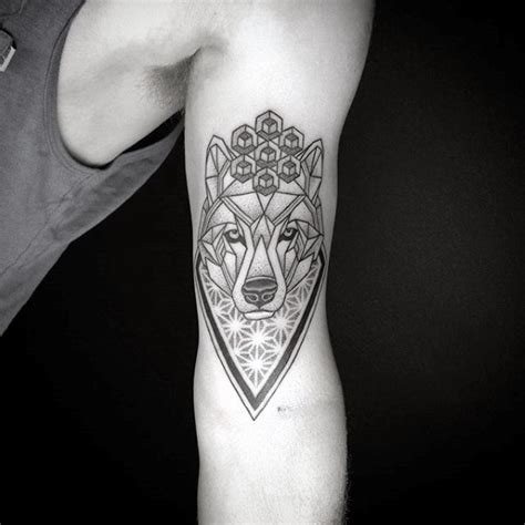 flower of life geometric wolf tattoos for guys on bicep of