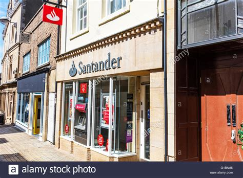 bank shop santander bank sign shop front name signs logo exterior