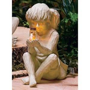 outdoor figures lighted boy or children with solar fireflies lighted