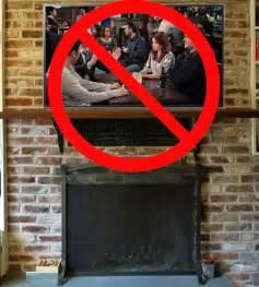 mount a tv a fireplace don t mount a tv above a fireplace cnet