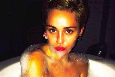 miley cyrus in a bathtub how far will she go miley cyrus posts naked bath selfie