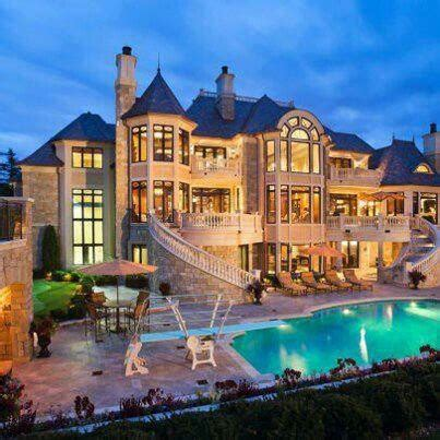 castle like house with stairs leading to pool big houses mansions house