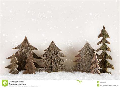 Handmade Trees - handmade carved trees on wooden white background