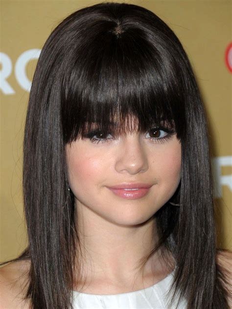bangs for short foreheads the best and worst bangs for round face shapes selena