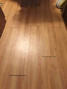 the vinyl plank click flooring i installed in two rooms develops gaps at the ends between the