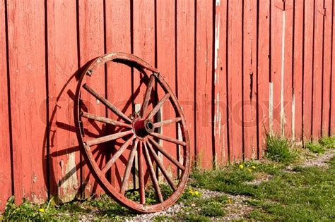 Rustic Log Home Plans Old Rustic Wagon Wheel Beside A Red Barn Stock Photo