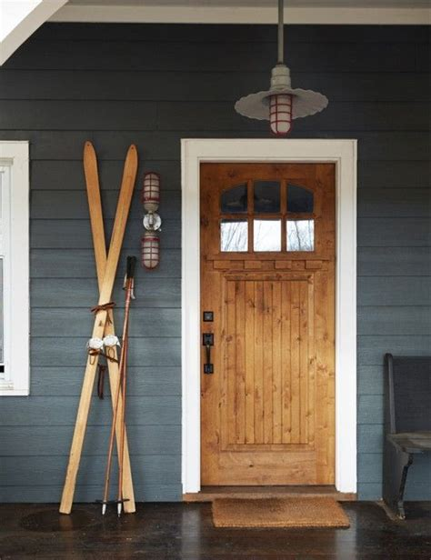 dark rustic wood through the front door rustic industrial home with a very particular design