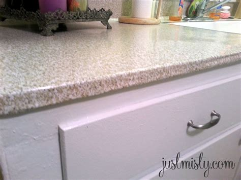 Redo Old Kitchen Cabinets by Using Contact Paper To Cover And Redo Countertops