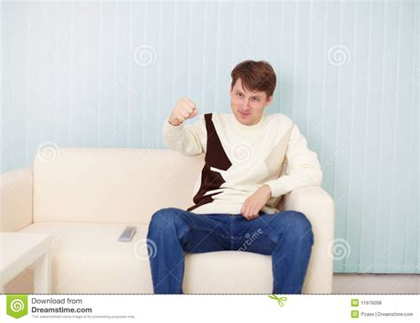 person on couch people sits on sofa with remote control royalty free stock