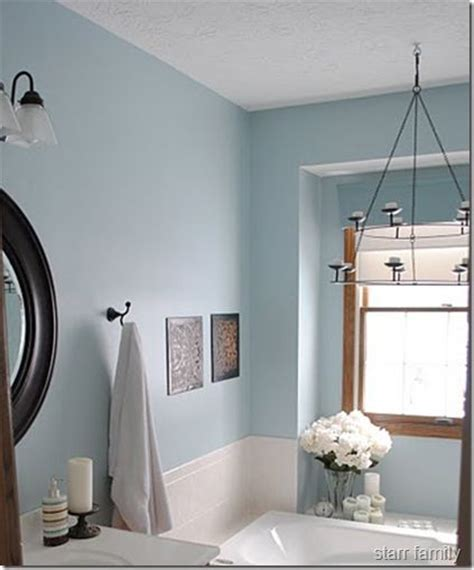 blue taupe bathroom agrees with taupe tile and oak trim also has rubbed bronze fixtures