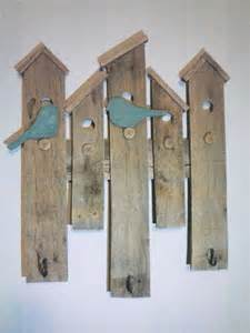 coat hooks bird houses and wall hangings on