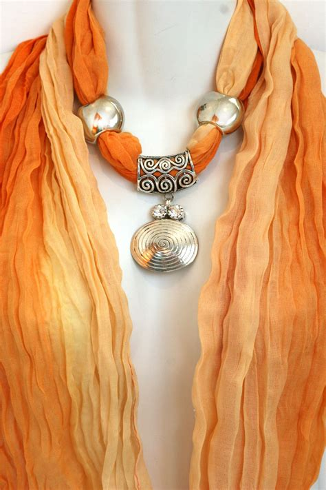 orange scarf with jewelry pendant scarves by