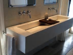 bathroom with 2 sinks one large sink with two faucets for bathroom
