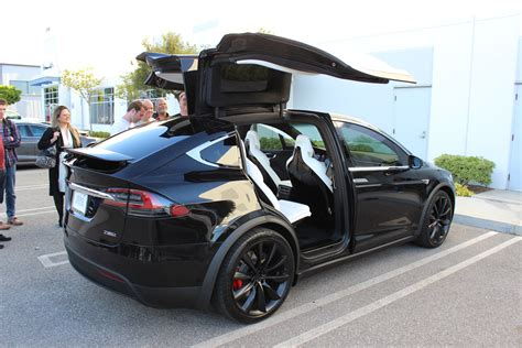 suv tesla exclusive model x review tesla model x is the best suv