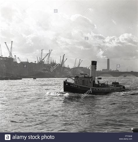 thames river great britain 1950s 1950s historical tugboat goes down the river thames