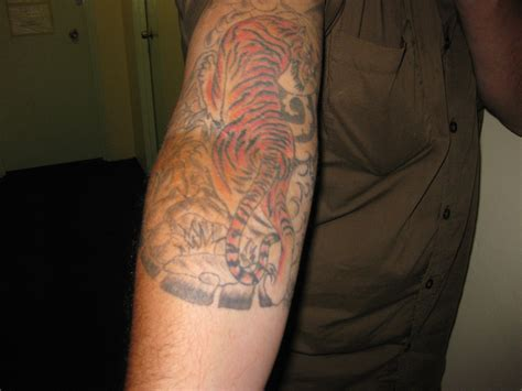 tattoos on bicep tiger tattoos designs ideas meaning me now