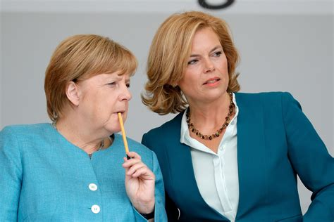 v und r bank merkel ally says website hit by thousands of cyberattacks