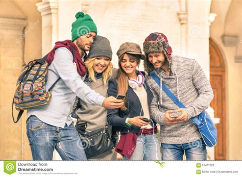 hipster male student showing thumb group stock photo group of young hipster tourist friend having fun with