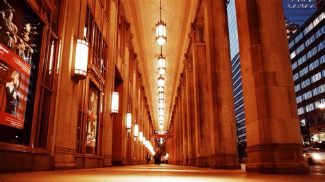 civic opera house chicago man looks up at columns outside chicago civic opera house beautiful chicago photos
