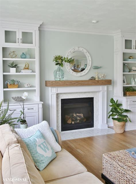 coastal dining room makeover sand and sisal coastal decorated fireplace coastal family room and